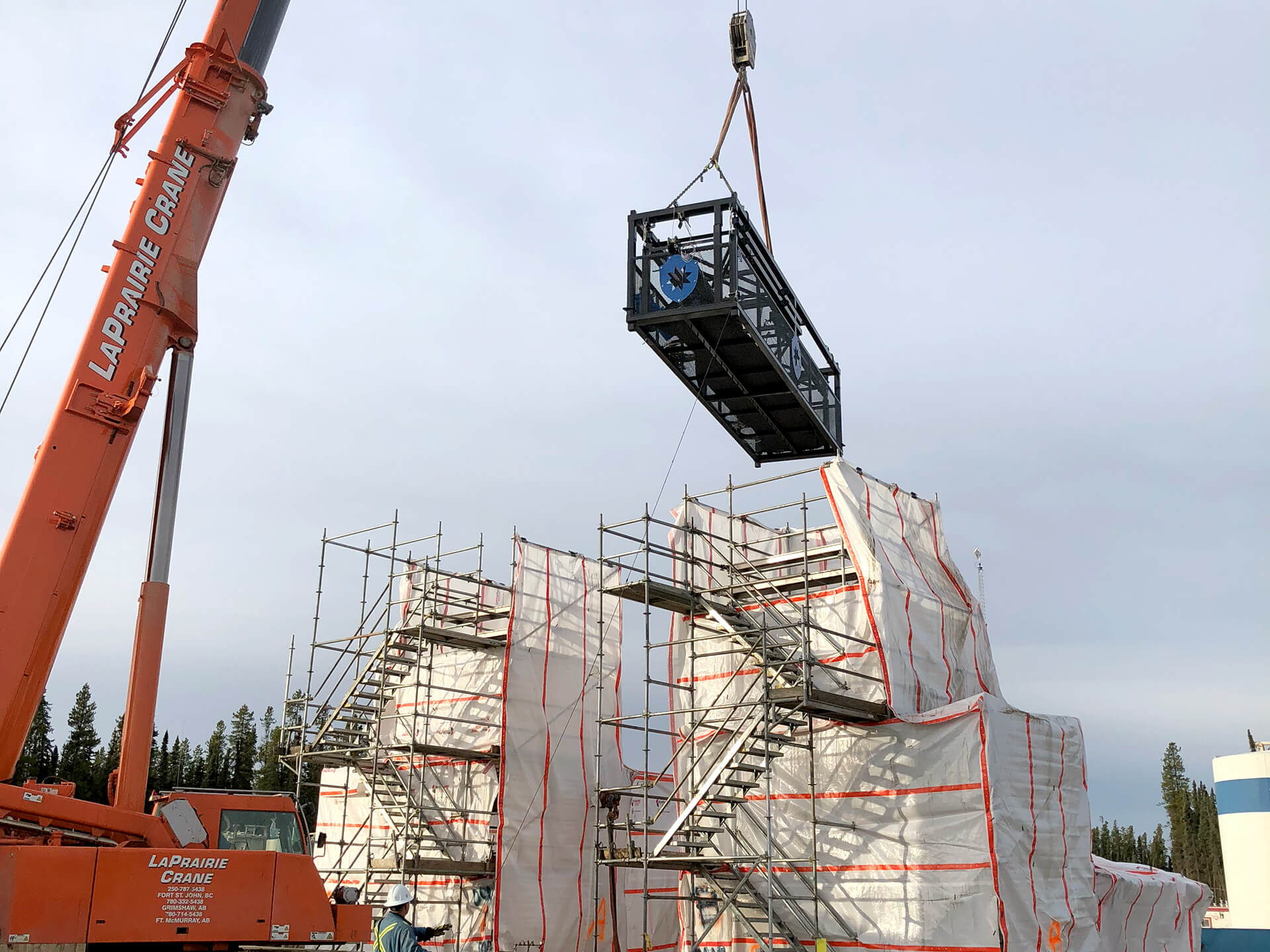 Blast Control DBX Deployable Barrier System hoisted by crane