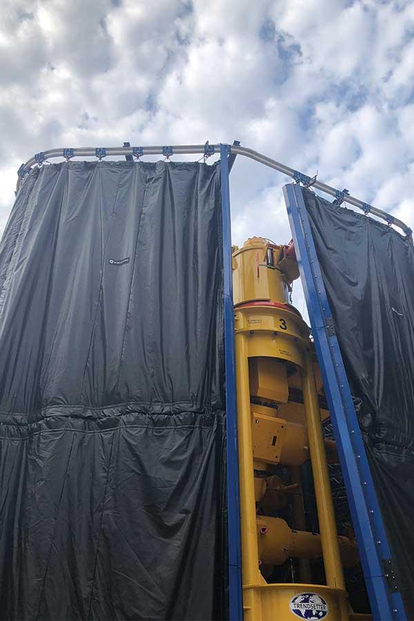 Equipment Inside Tall Rail Mounted Blast Control Curtain