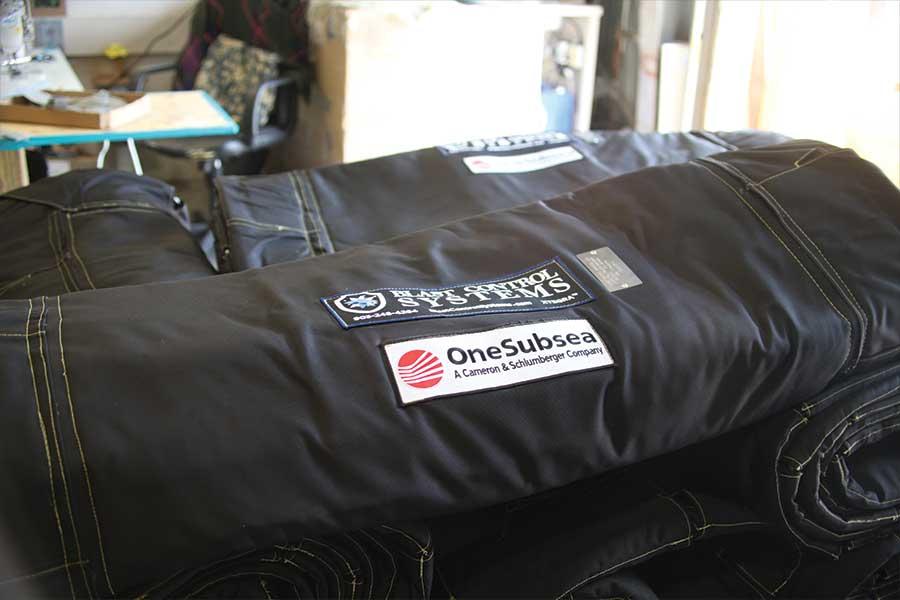 Stack of Blast Control Blanket Wraps With Custom OneSubsea Branding