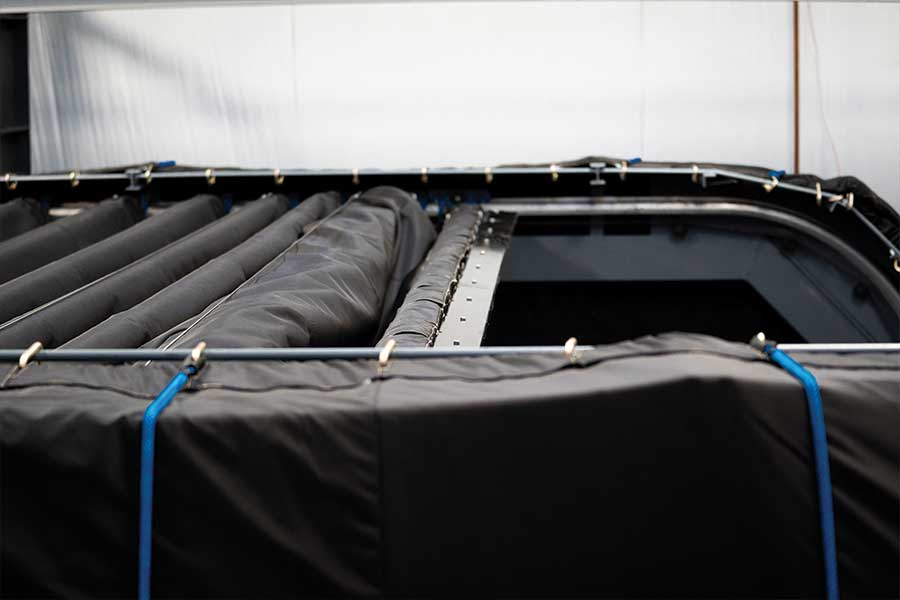 Close Up Of Pressure Test Enclosure's Door And Roof Edge While It Retracts